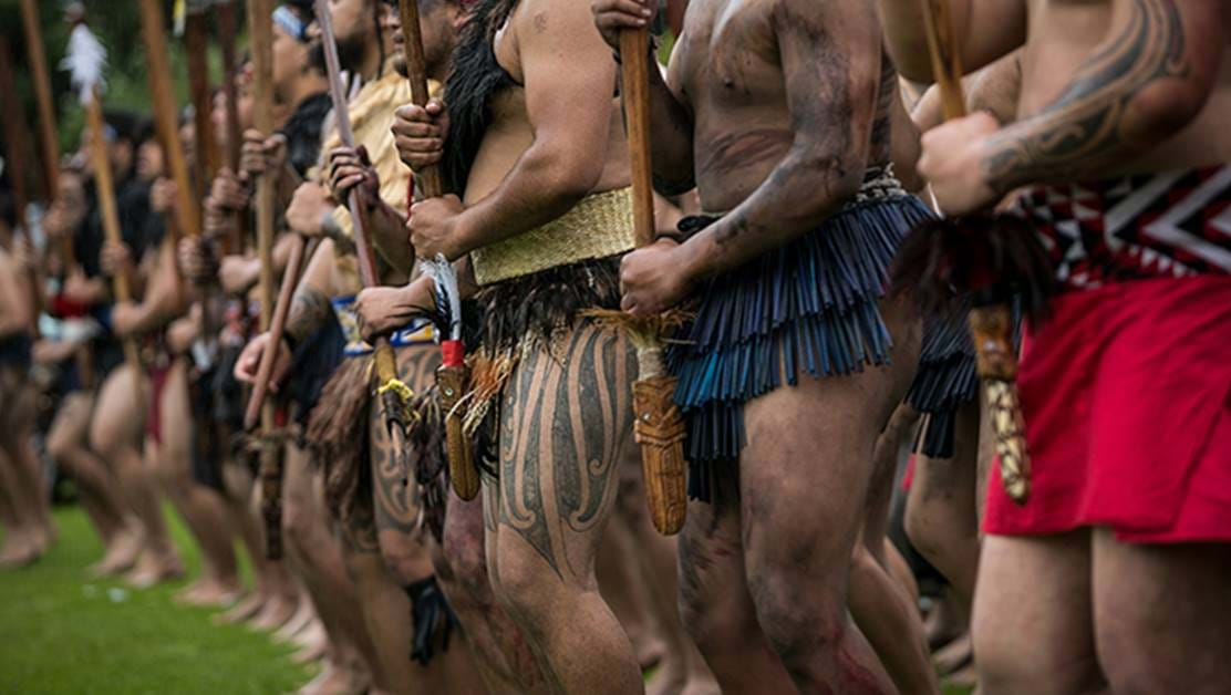 A group of men doing a haka.