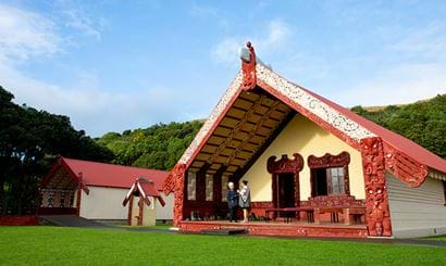 Two women standing at the marae.