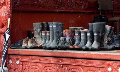 A row of gumboots at the marae.